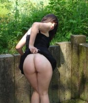 Posing and sucking a cock outdoors