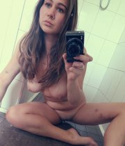 College girl with beautiful eyes showing her nudes