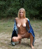 Sexy blonde naked in nature
