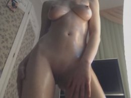 Hot Busty Redhead Pours Oil Over Herself And Displays Her Body