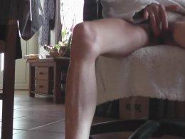 Skinny girl in a bathrobe masturbating on a chair