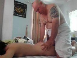 Alluring brunette woman spreads her legs for a mature bald fellow