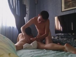 Young amateur couple having a great time on a bed