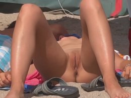Guy worshiping his wife's ass on the beach