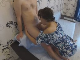 Hot mom giving a handjob and fucking a younger guy