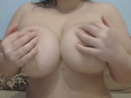 Chubby girl with large breasts touching her pussy
