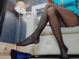 Long sexy legs in black pantyhose teasing