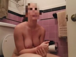 Shy amateur girl trying to masturbate on the toilet seat