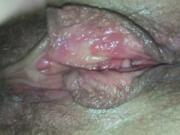Rubbing and fingering a hairy pussy up-close