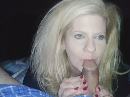 Blonde wife on her knees giving head to her hubby