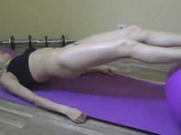 Slim fit girl doing yoga naked and oiled up