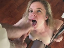 Stunning MILF in black lingerie getting a facial