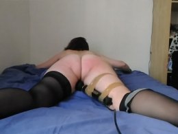 Submissive girl with a taped vibrator