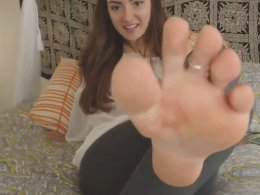 Pretty chick likes to film her small feet
