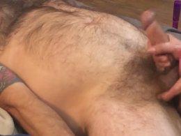 Tattooed guy gets his big dick jerked
