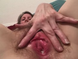 Long dildo stretches a hairy pussy