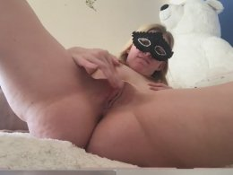 Wife with a mask tries out a dildo