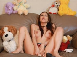 Solo schoolgirl likes to masturbate on the couch