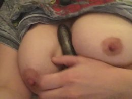 Busty girl jerks a dildo with her tits