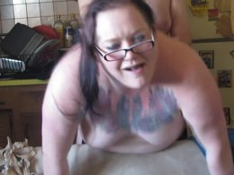 Tattooed BBW has fun with a delicious cock