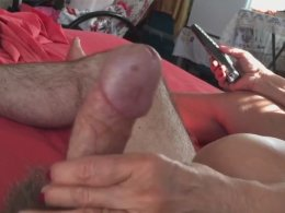 Pretty babe jerks a long hairy dick