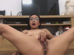 Nasty brunette girl runs her wet pussy