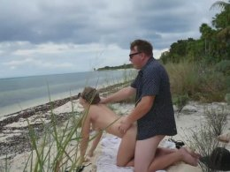 Couple being naughty on a vacation beach and having sex
