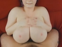 Purple haired busty BBW babe gives an amazing titjob and gets cum