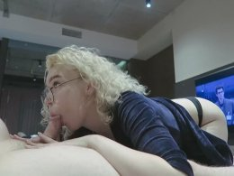 Eager blonde girlfriend with glasses sucks and swallows on the couch