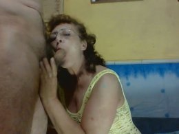 Amateur Hungarian granny with glasses sucks a hairy dick deep