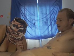 BBW girlfriend blows cock and licks balls with a mask on