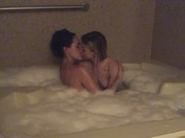 Best friends in a jacuzzi tub