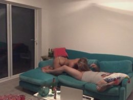 Busty blonde jumps on a friend's hard dick on the couch