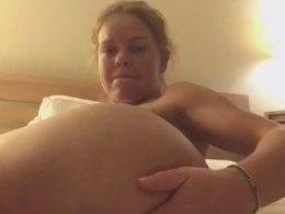 Lonely blonde masturbates on her bed using her fist