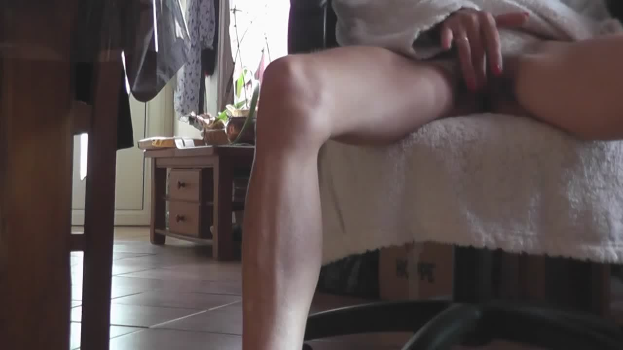 Skinny girl in a bathrobe masturbating on a chair