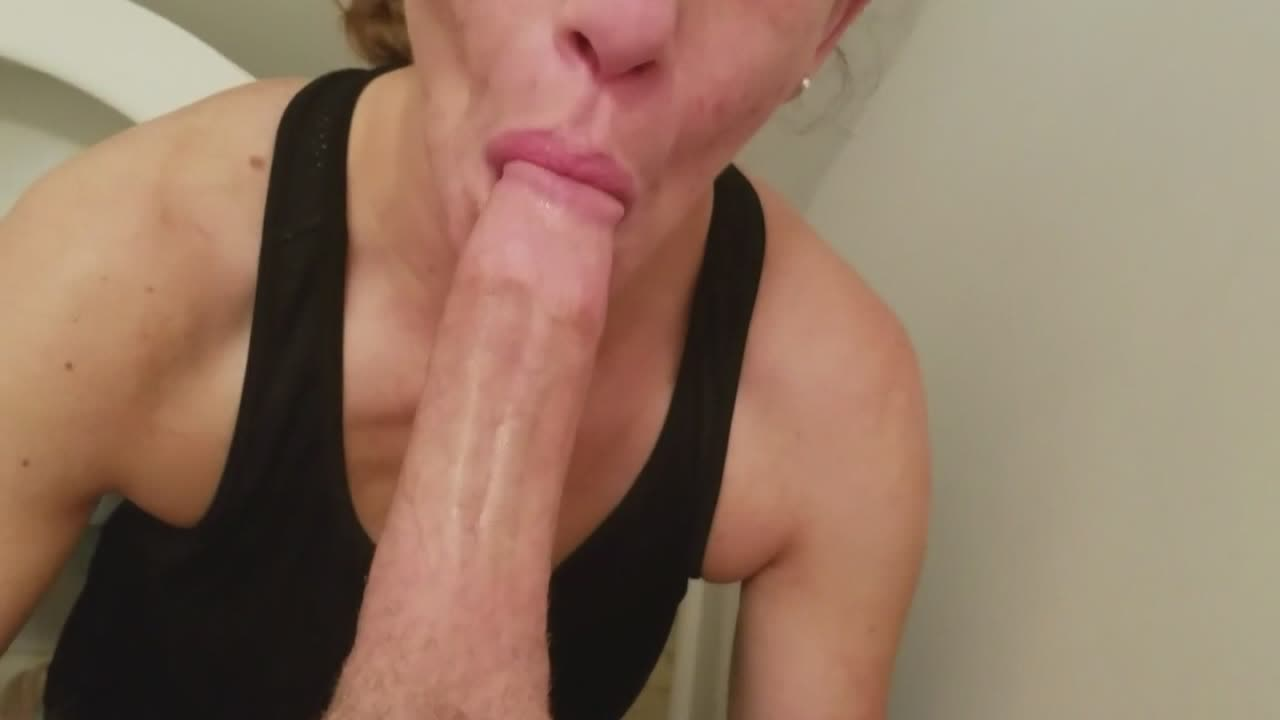 Mature wife gives a blowjob in the bathroom