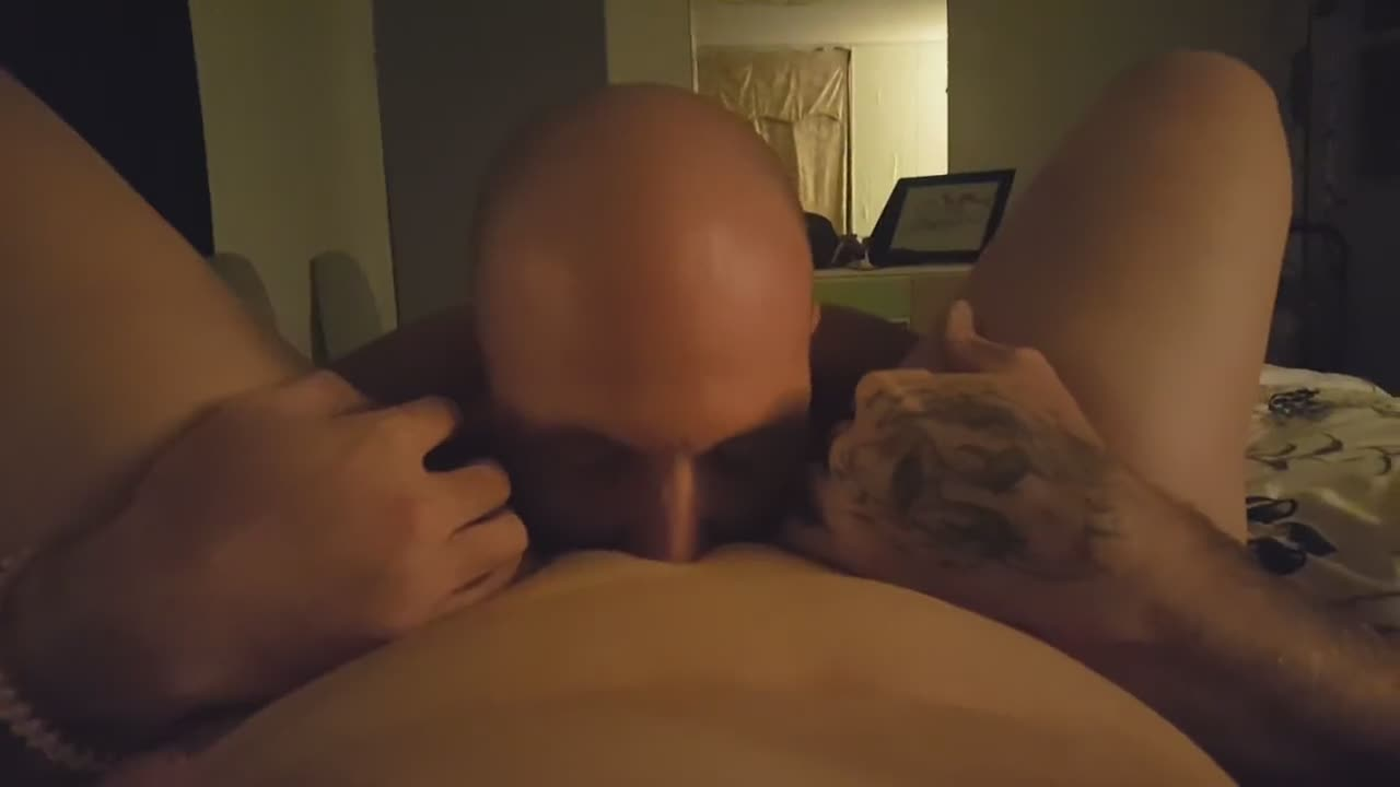 Wife holding a camera while hubby licks her pussy